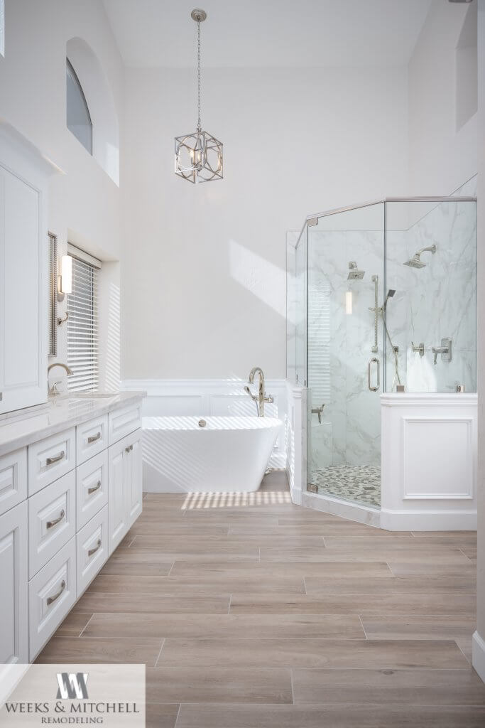 Luxury white master bathroom with freestanding tub